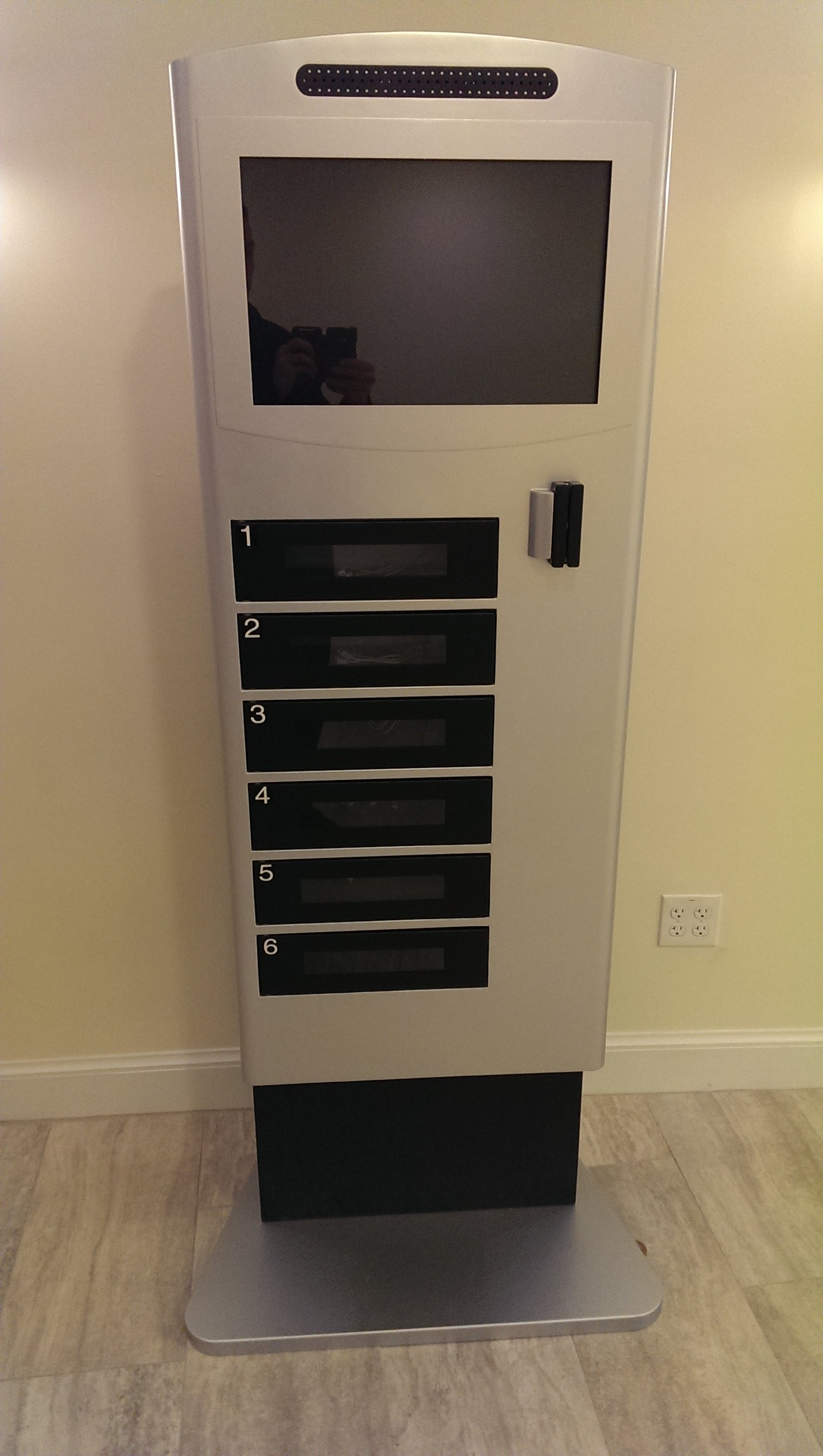 Cell phone charging stations with lockers Cell phone charging station