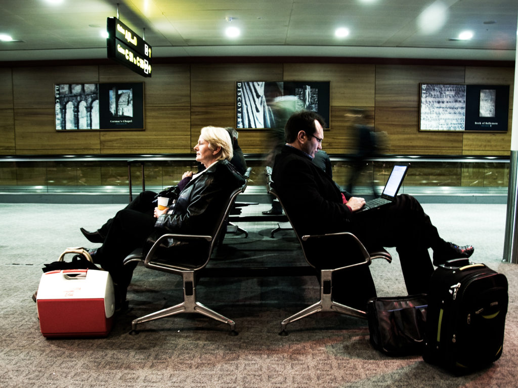 Two people waiting for flight at airport